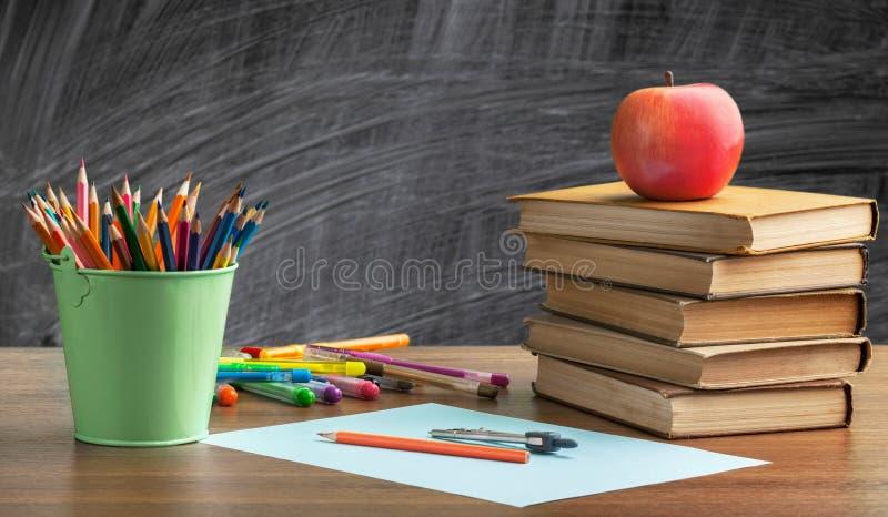 School desk. Chalkboard school back accessories apple back to school royalty free stock photo