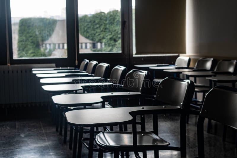 School desks in a classroom royalty free stock image