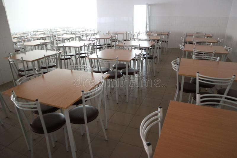 School Dining Room With A Lot Of Tables And Chairs Stock Image