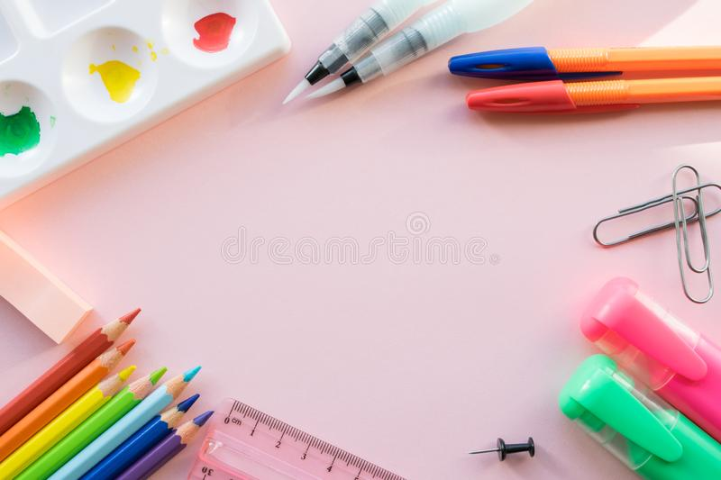 School drawing supplies on pink background. Free space for text royalty free stock photo