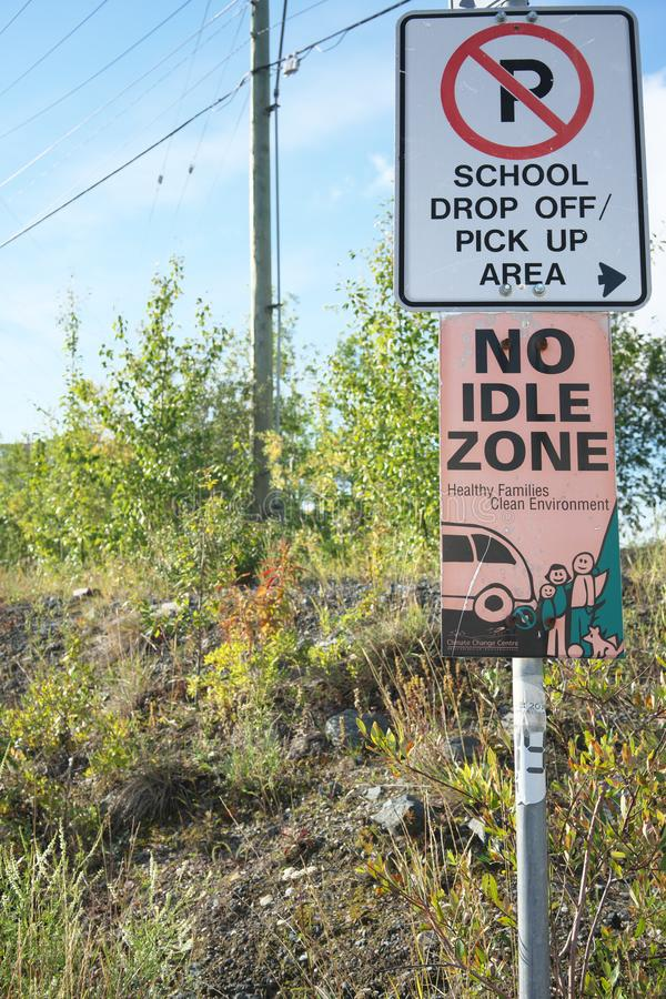 School drop off pick up area no idle zone sign in Yellowknife, Canada royalty free stock photography