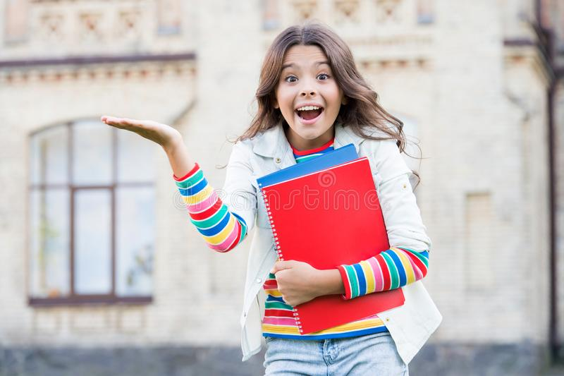 School education. Modern education. Kid smiling girl school student hold workbooks textbooks for studying. Education for royalty free stock image