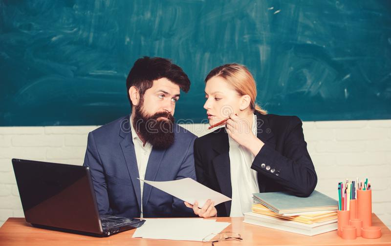 School education. Take into account educational norms. Prepare for school lesson. Teacher and supervisor working in stock photo