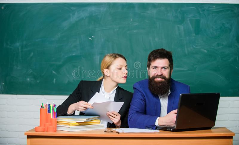 School educator with laptop and principal with documents. School education. Prepare for school lesson. Annual report. Teacher and supervisor working together royalty free stock image
