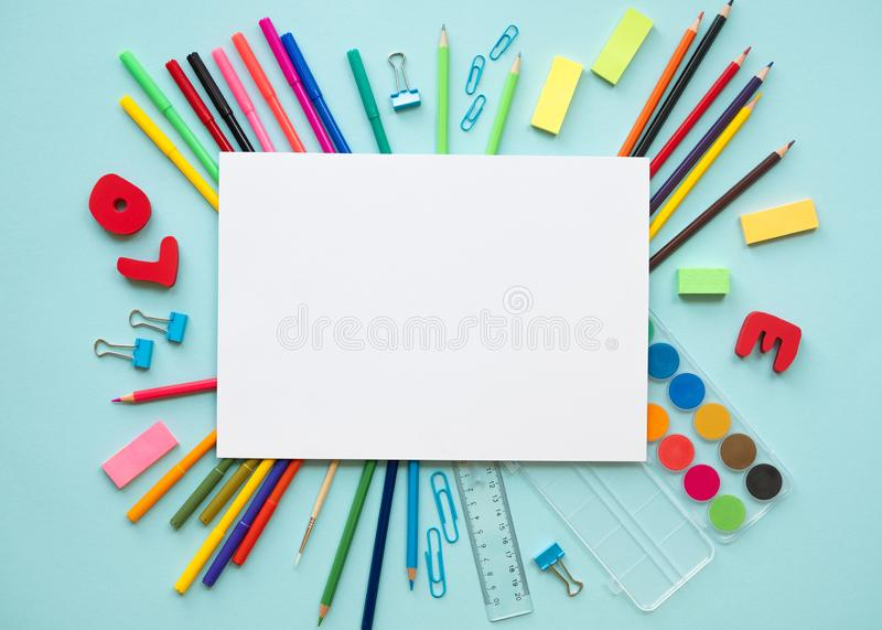 School elements on blue background with space for text symbolizing back to school. School elements on blue background with space for text symbolizing back to stock images