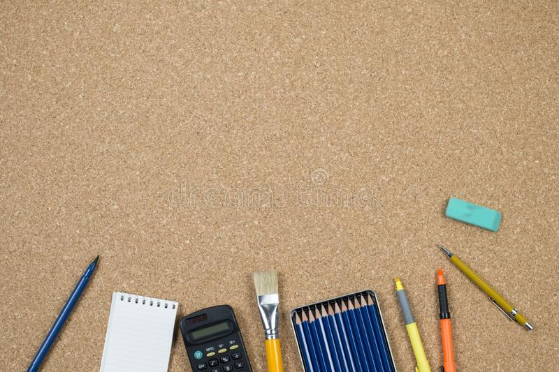School elements on cork background with space for text symbolizing back to school stock photos