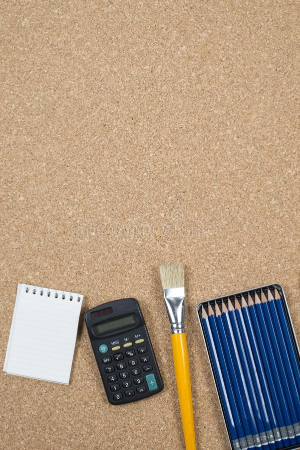 School elements on cork background with space for text symbolizing back to school stock photography