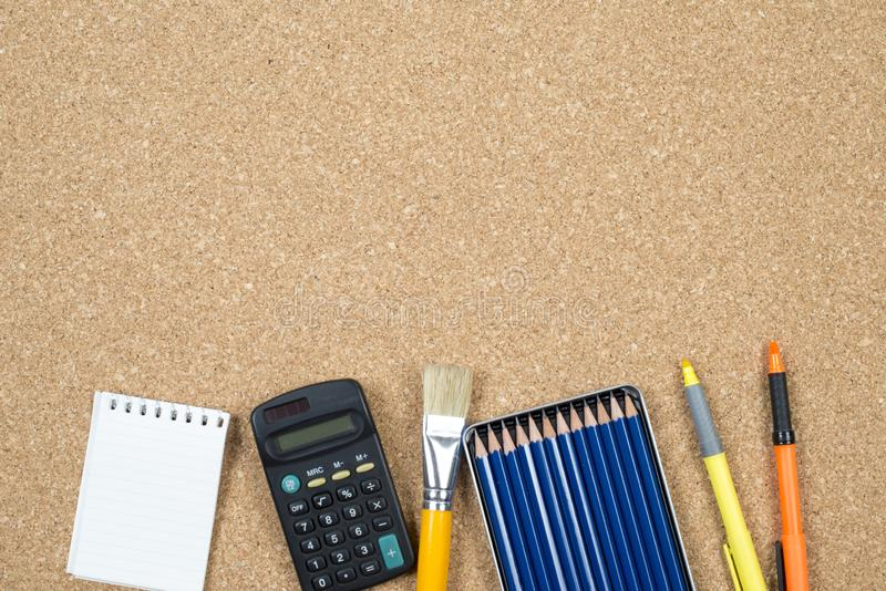 School elements on cork background with space for text symbolizing back to school royalty free stock photos