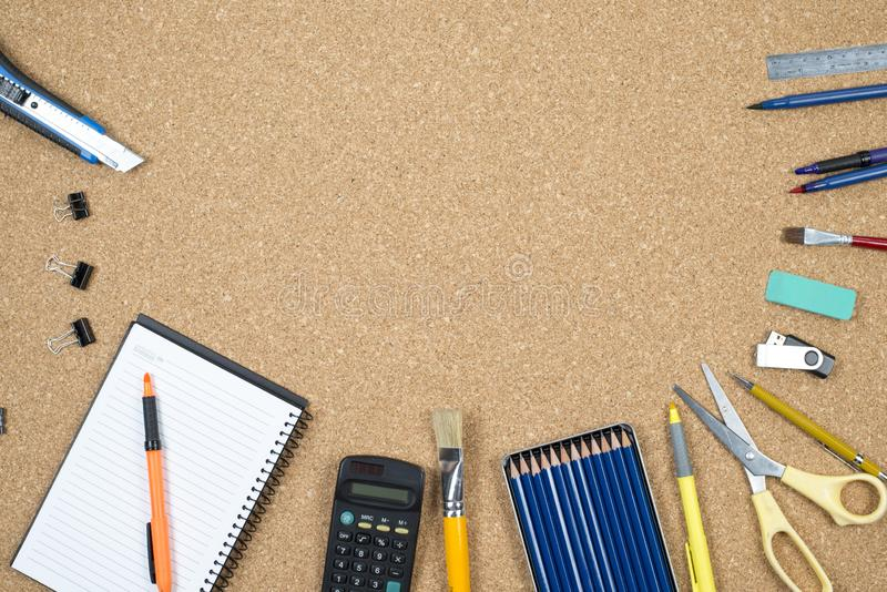 School elements on cork background with space for text symbolizing back to school.  royalty free stock photo