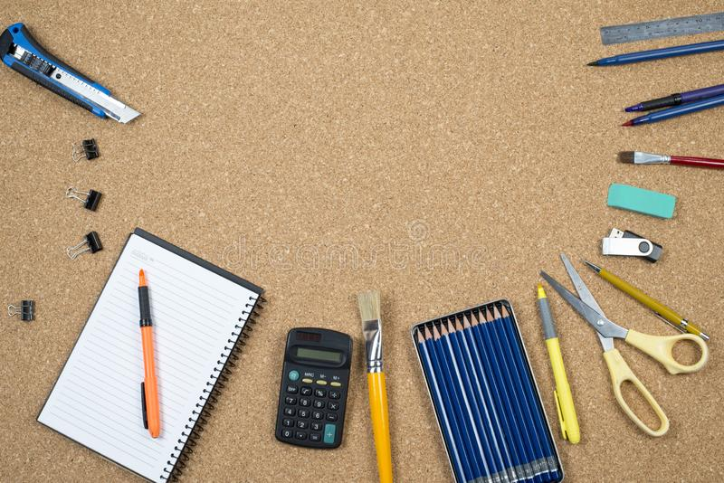 School elements on cork background with space for text symbolizing back to school. School elements on cork background with space for text symbolizing back to royalty free stock photography