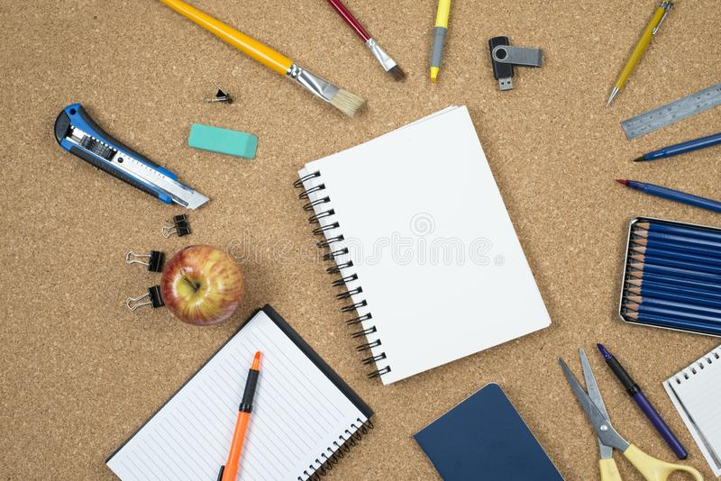 School elements on cork background with space for text symbolizing back to school. School elements on cork background with space for text symbolizing back to stock photography