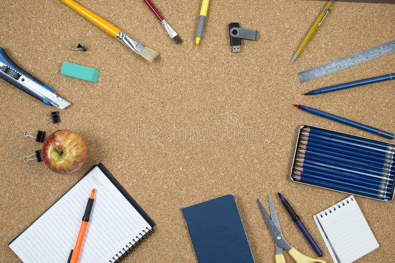School elements on cork background with space for text symbolizing back to school. stock photos