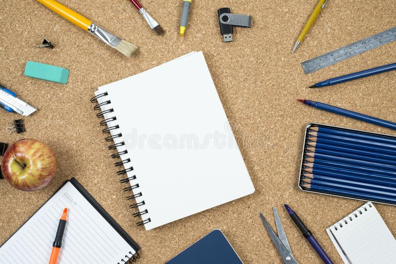 School elements on cork background with space for text symbolizing back to school. royalty free stock photos