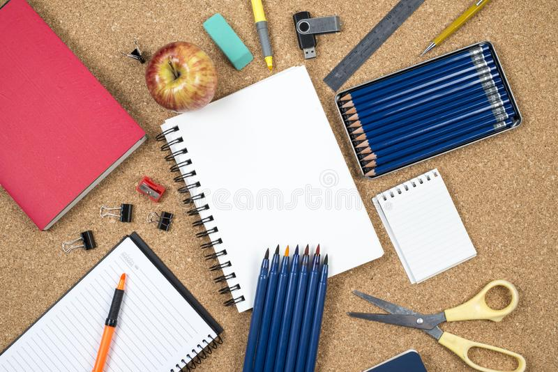 School elements on cork background with space for text symbolizing back to school. stock photography