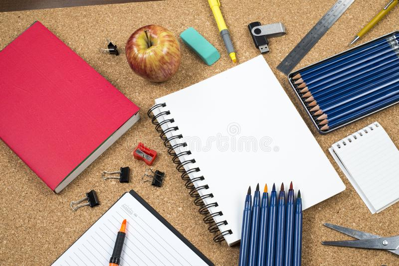 School elements on cork background with space for text symbolizing back to school. stock images