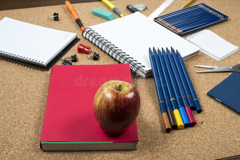 School elements on cork background with space for text symbolizing back to school. stock image