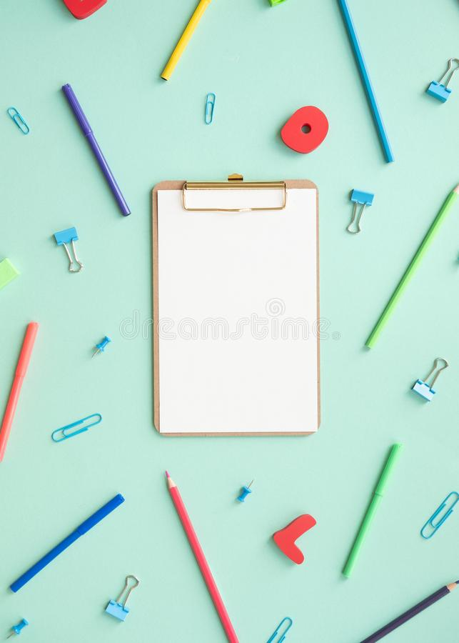 School elements on green background with space for text symbolizing back to school. stock image