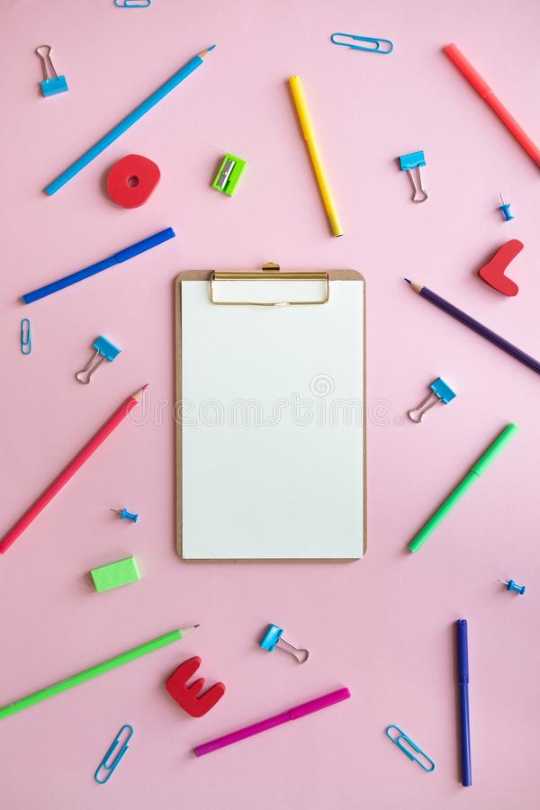 School elements on pink background with space for text symbolizing back to school. School elements on pink background with space for text symbolizing back to royalty free stock photography