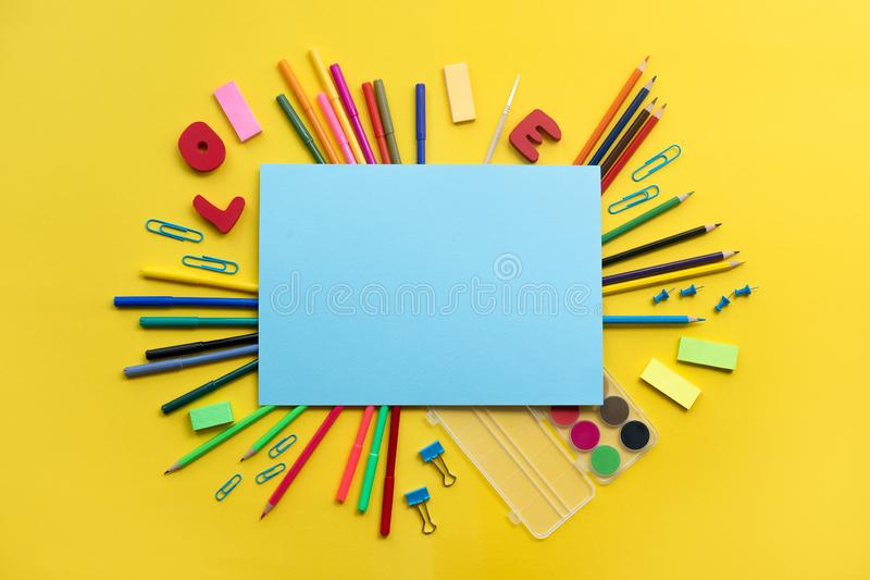 School elements on yellow background with space for text symbolizing back to school. School elements on yellow background with space for text symbolizing back royalty free stock image
