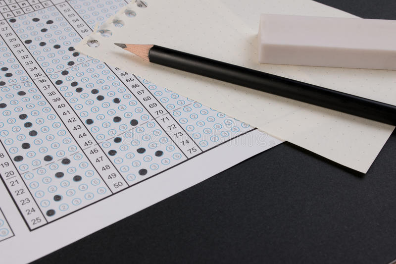 School exam answer sheet and pen. Standard test form or answer sheet. Answer sheet focus on pencil. royalty free stock photography