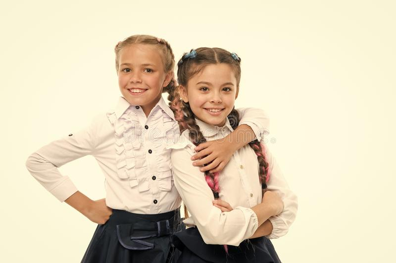 School fashion concept. Be bright. School friendship. Sisterhood relationship and soulmates. On same wave. Schoolgirls. Wear formal school uniform. Sisters royalty free stock photography