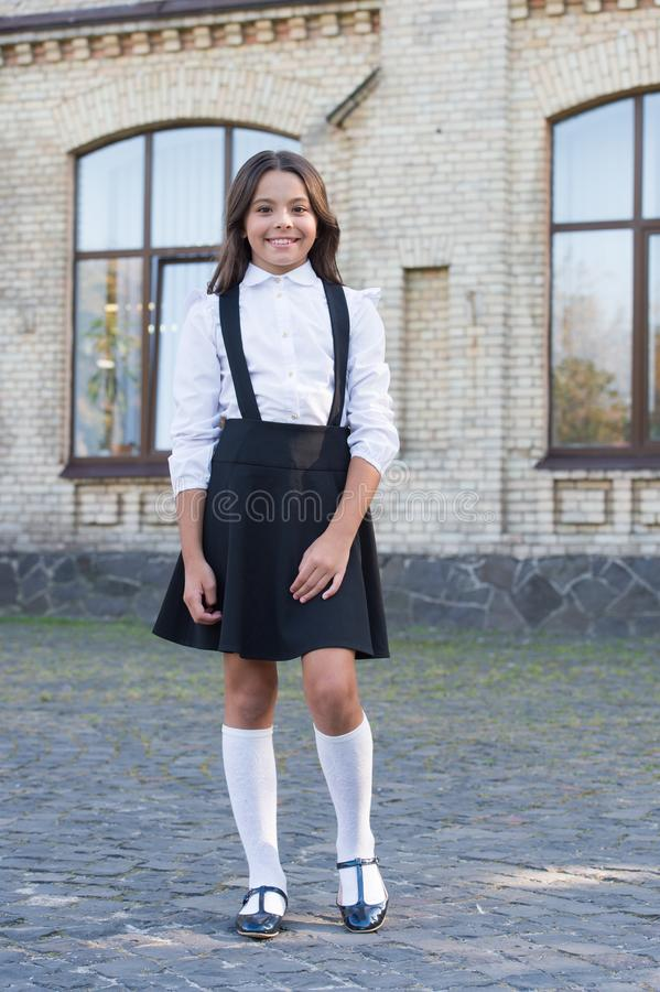School fashion. Girl wear fashionable outfit. White shirt and black dress. Classic style. Formal clothes for visiting. School. Daily outfit. Adorable schoolgirl stock photo