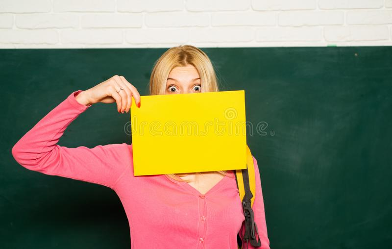 School. Female student portrait. Portrait of young girl in classroom. University student posing on blackboard. Beautiful stock photography