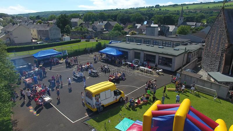 School Fete day Co Antrim Northern Ireland. Fun kids children playing royalty free stock photography