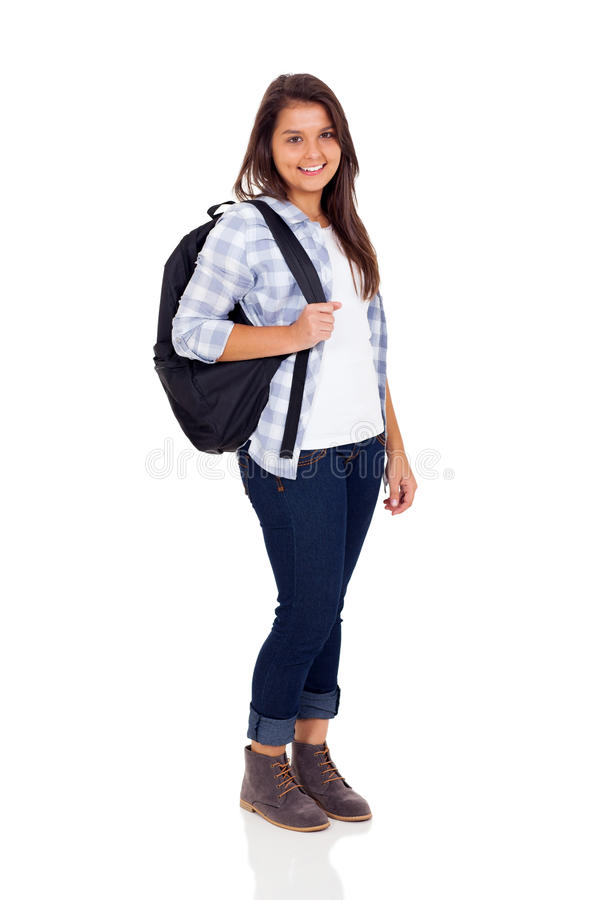School girl backpack. Smiling teen high school girl with backpack isolated on white background royalty free stock image