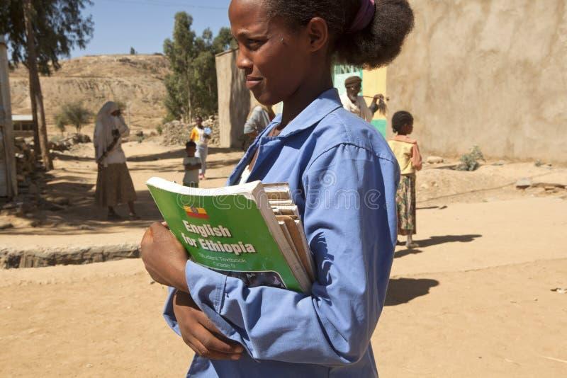 School girl, Ethiopia. A school girl carrying books in Ethiopia stock photos