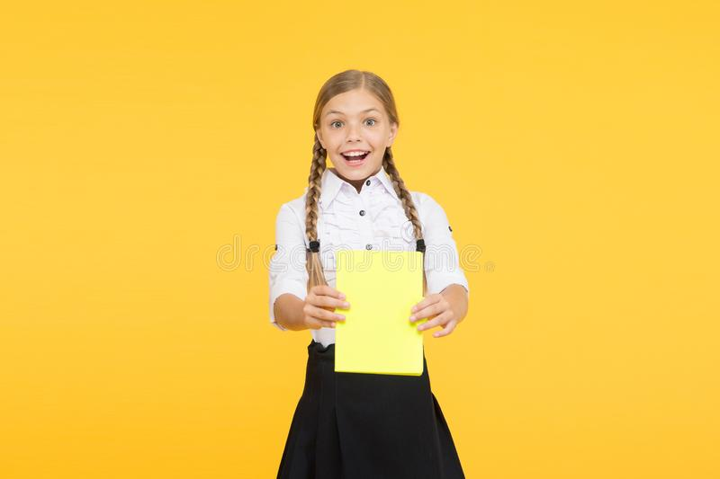 School girl excellent pupil prepared essay or school project. Raising independence. Schoolgirl wear school uniform. Knowledge day. Girl with copy book or stock images