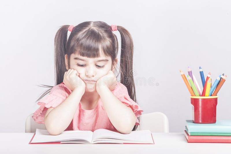 Education concept with worried school girl stock photography