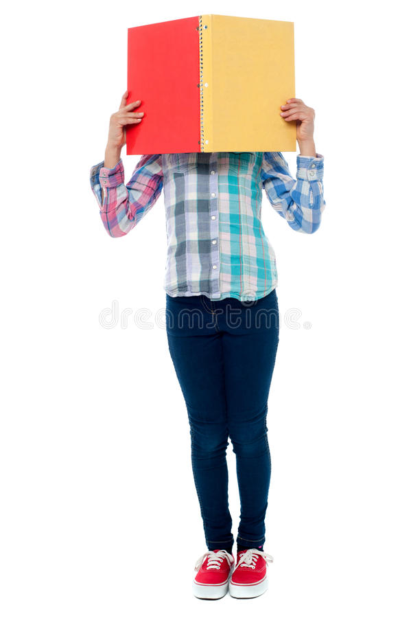 Download School Girl Hiding Her Face Behind A Notebook Stock Image - Image: 32848481
