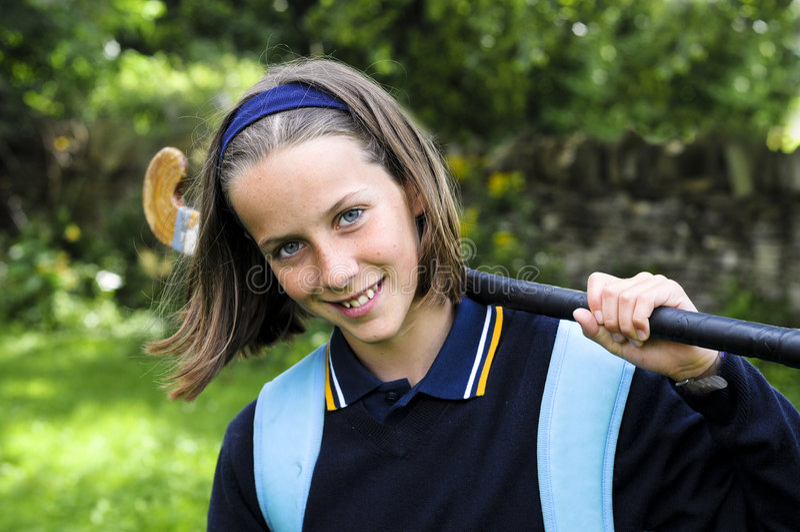School girl with hockey stick stock photos