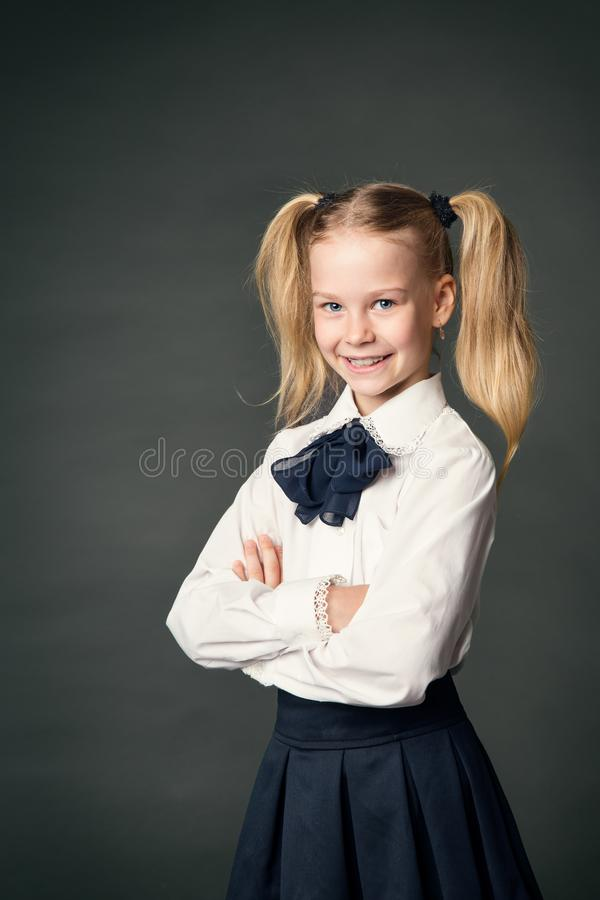 School Girl over Blackboard Background, Happy Child Portrait stock image
