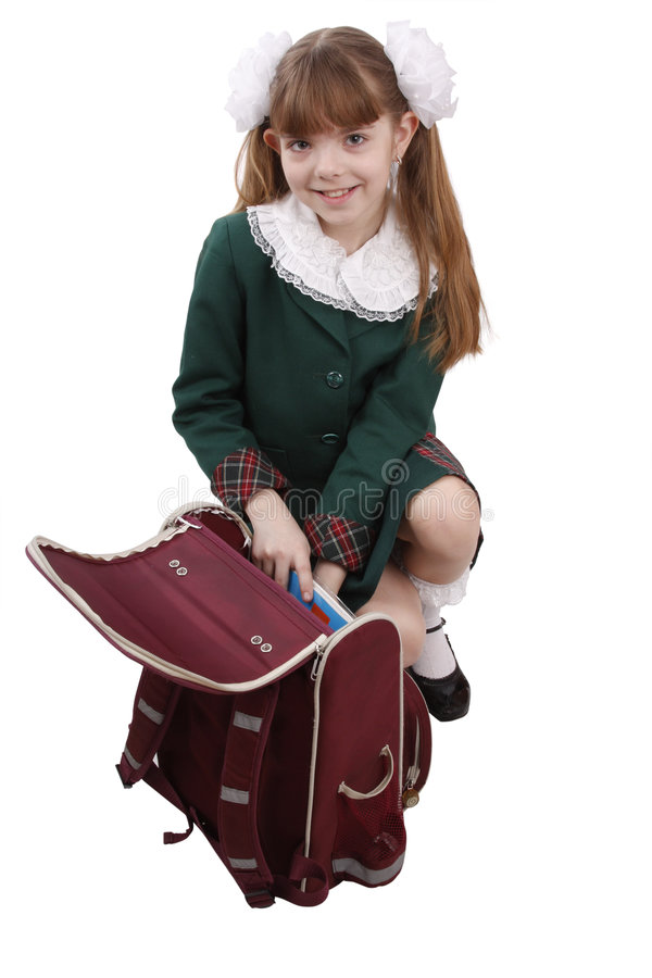 School girl is packing up backpack. royalty free stock photography