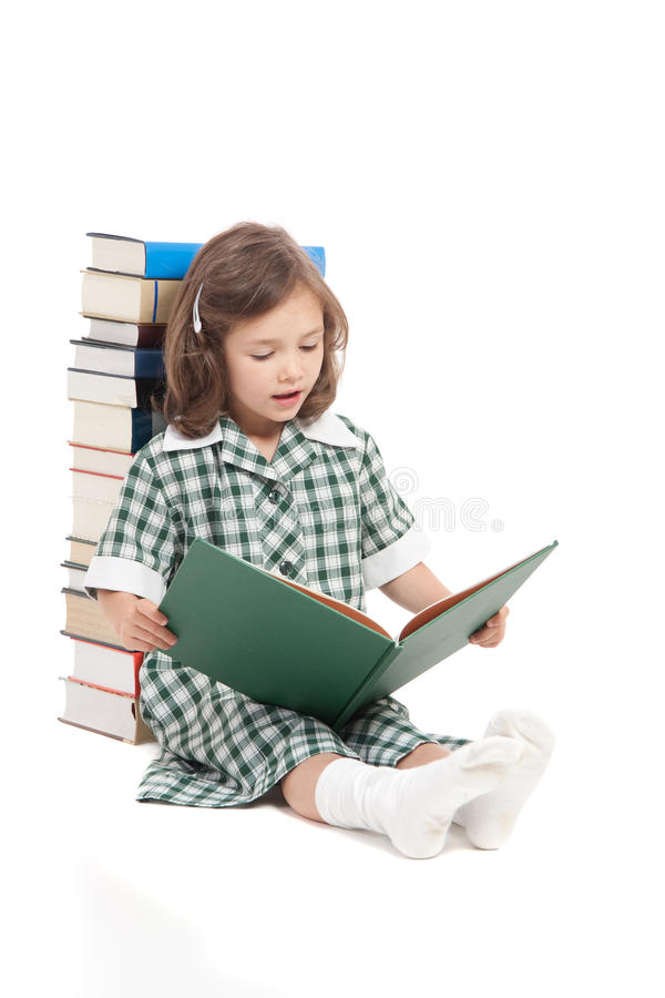 School girl reading library book stock image