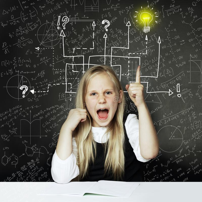 School girl with thumbs up and question signs and light idea bulb, education concept stock image