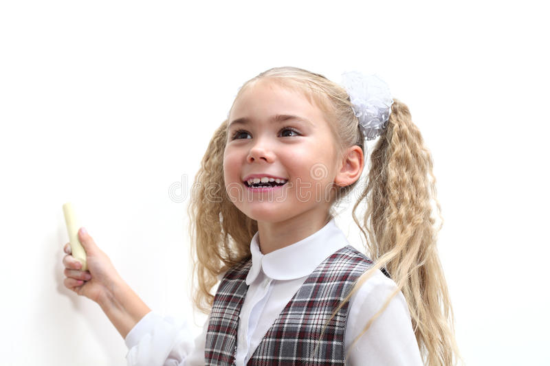 School girl writing with a chalk royalty free stock images
