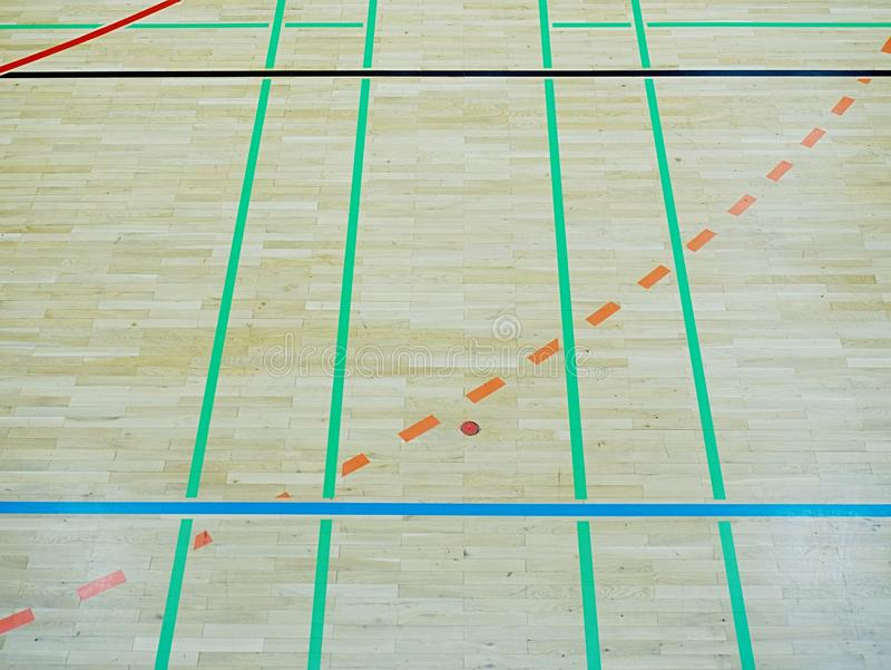 School gym floor. Wooden floor of sports hall with colorful lines. School gym floor. Wooden floor of sports hall with colorful marking lines royalty free stock images
