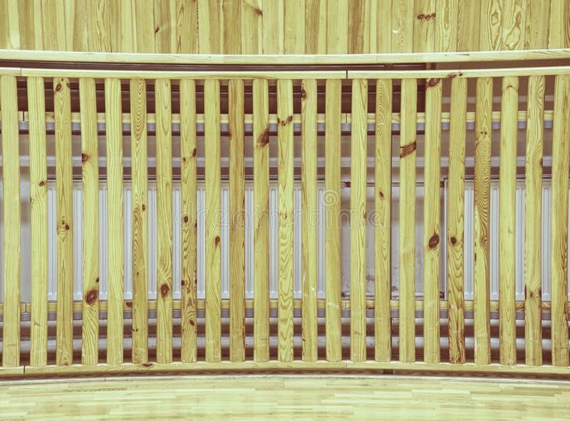 School gym hall with heating system over wooden bars cover. Schooll gym hall with water heating system hidden over wooden bars cover.  Basketball court. Lines of stock image
