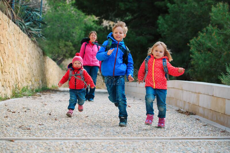 School holiday- happy kids running to play. Coming from school and daycare stock photography