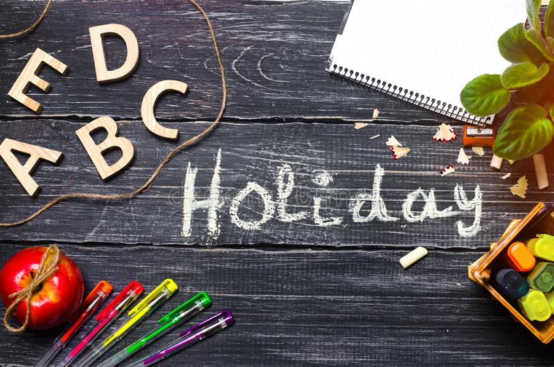 School holidays inscription, school desks, school accessories, the end of the school year. School`s Out. School holidays inscription, desks, accessories, the end stock photo