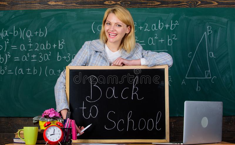 School. Home schooling. happy woman. teacher with alarm clock at blackboard. Back to school. Teachers day. woman in stock images
