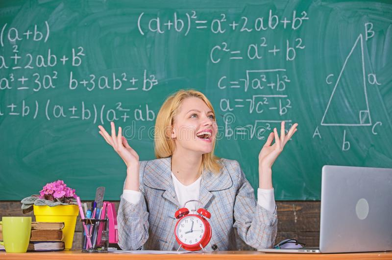 School. Home schooling. happy woman. teacher with clock at blackboard. Back to school. Teachers day. woman in classroom royalty free stock photography
