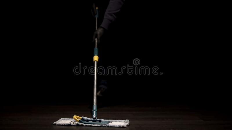 School janitor washing floor after lessons, low paid job, labor migration stock images