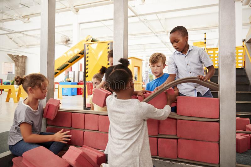 School kids building with toy bricks at a science centre stock image