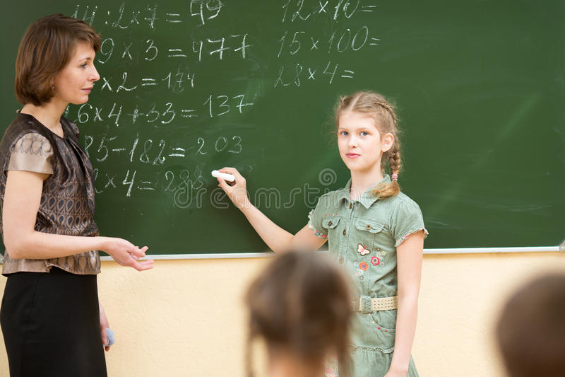 School kids in classroom stock images