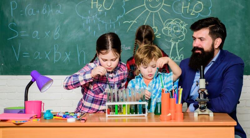 School kids scientist studying science. back to school. happy children teacher. Little kids learning chemistry in school stock image