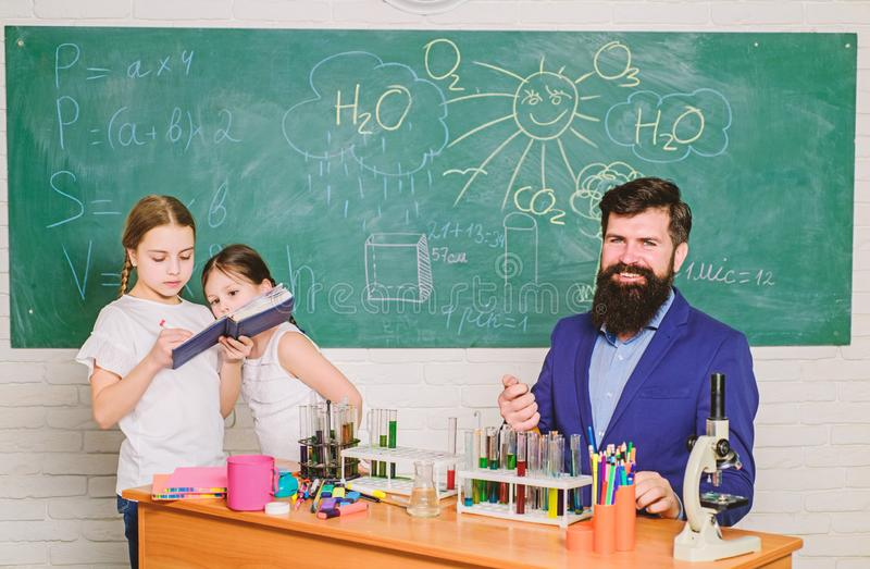 School kids scientist studying science. back to school. happy children teacher. Little kids learning chemistry in school royalty free stock images